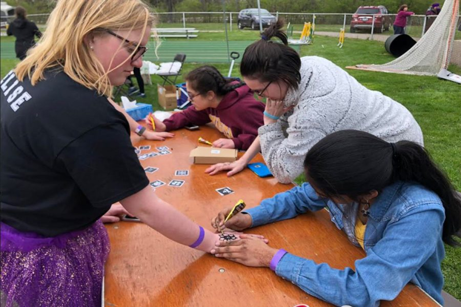 INKED. For the past few years, Relay For Life (RFL) had always made a henna stand. Participants can pay five dollars to get any design of their choice. This year, Akhila Durisala, the head of Henna Club at SHS, volunteered her time at the event.