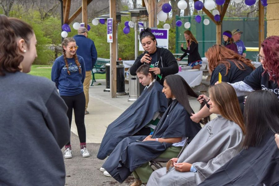 I GOT BANGS. Any person could also donate their hair during the event. RFL brought in volunteers from Great Clips to do the cutting. While most girls simply cut off a good length of hair, sophomore Lydia Masset shaved her head.