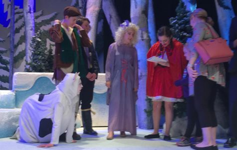 """SIGN HERE. Last year, the spring show was """"Into the Woods."""" During one of the performances, the musical was shortened and ridded of any subject matter that is not kid friendly. It was deemed a """"kids night"""" and after the show, the children could take pictures and get autographs from the characters."""
