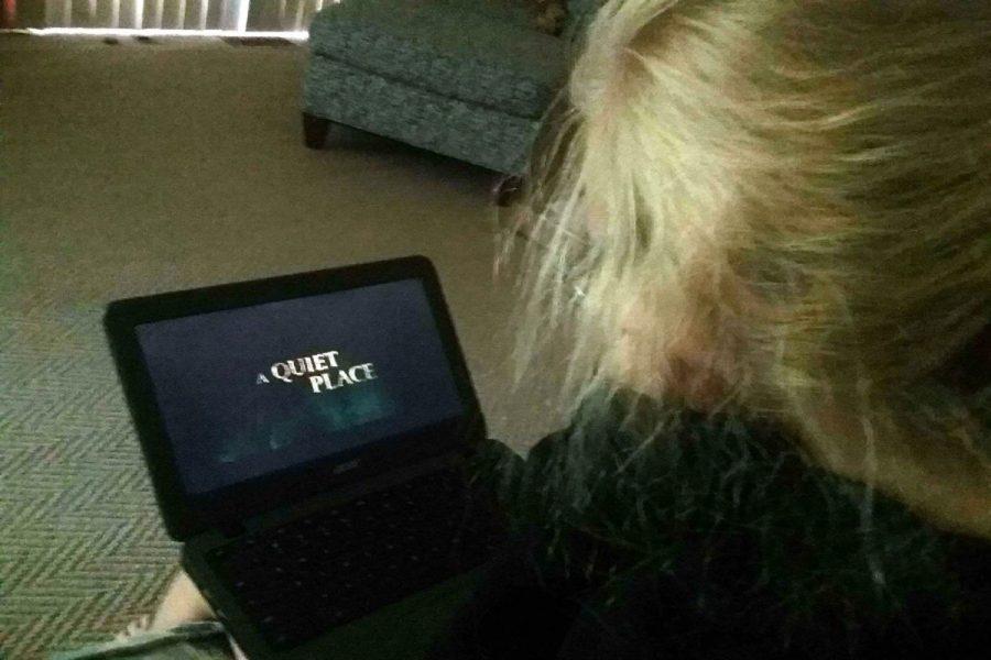NEW KIND OF HORROR. Freshman, Annamarie Jowanovitz,  watches the horror film