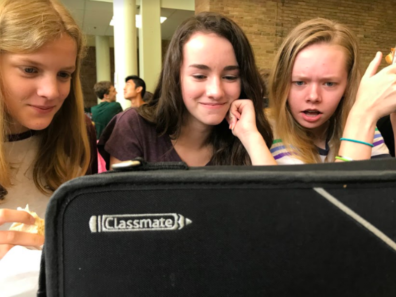 """STUNT IN ACTION. Freshmen Kelly Donovan, Julia Trenary, and Grace Caldwell watch the footage of Tom Cruise's stunt gone wrong. Cruise broke his ankle while attempting a dangerous stunt for his new movie, """"Mission Impossible: Fallout."""" """"I love actors who do their own stunts,"""" Caldwell said."""