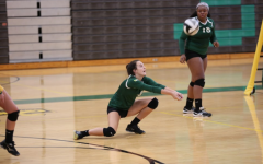 """DIVING SAVE. Sycamore JV girls volleyball played against Wyoming earlier this month and lost a close one. Sophomore Kelli Trumpy contributed greatly to the game with her many diving saves and blocks. """"[The team does not] give up on each other, and give[s] each other a lot of energy, """" Trumpy said."""