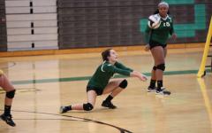 Girls volleyball bonds on court
