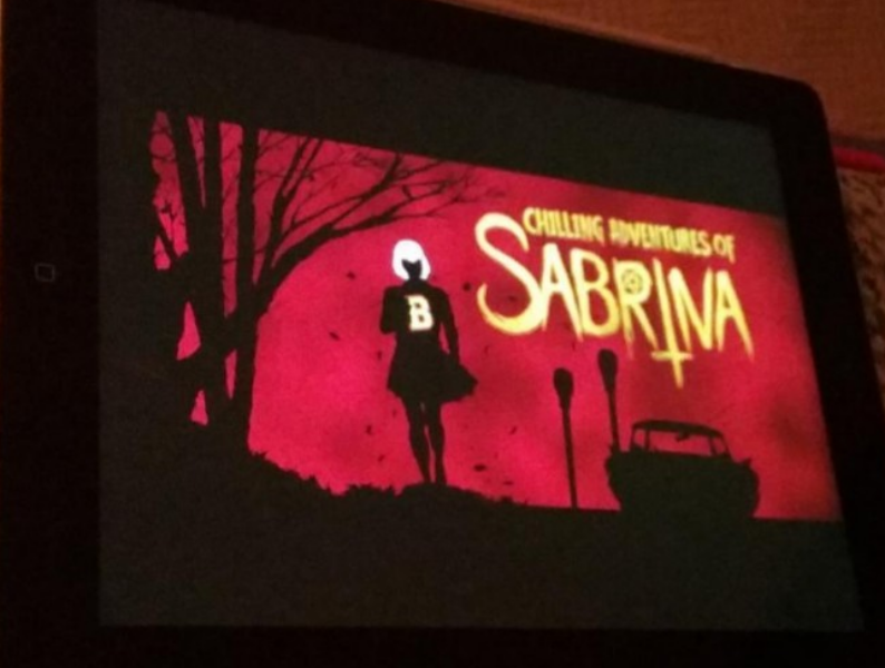 COMIC+BOOK+ROOTS.+The+opening+credits+for+Netflix%E2%80%99s+%E2%80%9CChilling+Adventures+of+Sabrina%E2%80%9D+is+stylized+like+the+comic+book+it+is+based+on%2C+but+the+new+show+could+not+be+more+different.+Comic+book+adaptations+can+be+tricky%2C+so+not+everything+crazy+that+happens+in+the+source+material+are+bound+to+be+to+show+up+in+the+show.+%E2%80%9CWith+a+comic+book+sensibility%2C+all+the+rules+can+go+out+of+the+window%2C%E2%80%9D+said+%E2%80%9CChilling+Adventures%E2%80%9D+production+designer+Lisa+Soper.