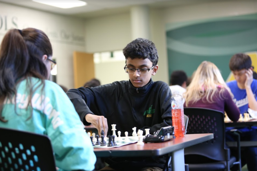 """CONCENTRATE. Sophomore Arvind Prasad focuses on the board as time winds down. He is Board One and was his freshman year too, though team members are allowed to challenge each other to get a higher board number. """"The seasons going pretty well. It's crazy that this is my last year of chess because I've played it all four years of high school,"""" said Nandita Kulkarni, 12."""