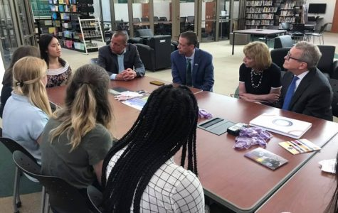 """LISTEN IN. Gov. Mike DeWine and First Lady Fran DeWine participate in a mental health roundtable discussion with SHS students, with Principal Doug Mader and Superintendent Frank Forsthoefel sitting in. Both the presentation of senior Madeline Hampson's scholarship and the roundtable were held in the Hub. """"It was a rectangular table, which was a little confusing,"""" said Katie Good, 12, who participated in the discussion."""