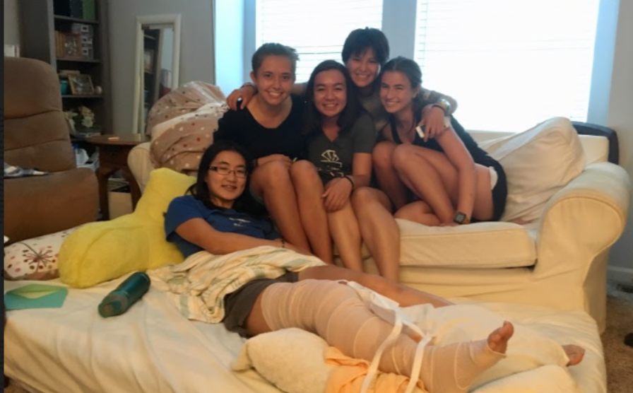 """ADVERSITY. Senior Mayu Fukuda is pictured with visiting friends after her surgery. Although Fukuda struggled greatly through her recovery, she acknowledges what it taught her. """"I have a slightly better understanding of how to cope with tough situations, how to rely on others in tough situations and how to mentally get through it,"""" Fukuda said."""