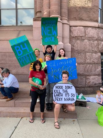 """A TEAM EFFORT. Senior Caroline Skwara, top right, poses with her fellow organizers at the Cincinnati Youth Climate Strike on Fri., Sept. 20. Creative signs like Skwara's handmade """"climate justice NOW"""" poster and fellow organizer Reilly Ackerman's (bottom right) poster, which references a popular Twitter post, served as a way for each striker to express themself and connect with other teenagers."""