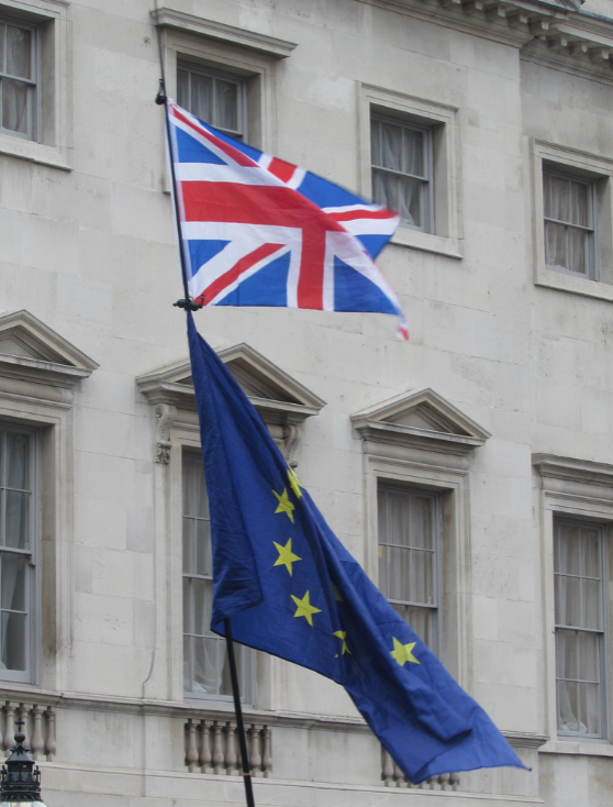 The British flag waves beside the flag of the European Union in the United Kingdom.