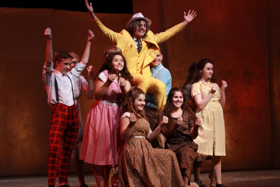 """BRIGHT. Here, Eli Cohen, 12, plays """"the Man in the Yellow Suit"""" held up by his cast members at the end of their number """"Everything's golden"""". Cohen played the antagonist trying to profit off of the Tuck's secret of eternal life. Aves Theater's next production """"She Kills Monsters"""" will take place on Jan. 30 and Feb. 1, and 2."""