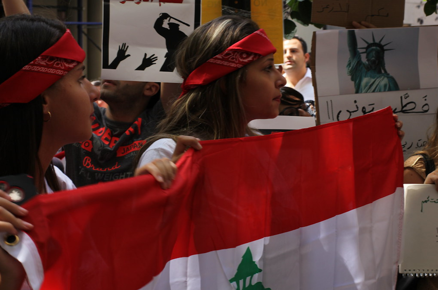 "PROTEST. Lebanese demonstrators carry flags and signs while marching through the streets, demanding an end to their injustice. Thousands of people have shown up to march in the streets for weeks now, whether in Lebanon or around the world, to protest their treatment by the government. ""This may be the biggest achievement for my generation, winning in a clash of this level with our politicians,"