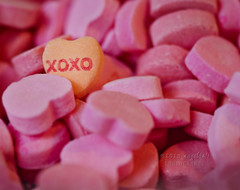 XOXO. This image displays one of the most popular candies on Valentine's Day: candy hearts. We give these to people with sweet notes written on each heart that they will read while taking out each candy.