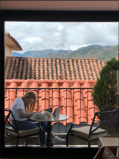 "STRANDED IN PERU. Sophomore Chloe Gordon works on her schoolwork while quarantined at a hotel in Cusco, Peru. The Gordon family became stranded in Peru along with thousands of other Americans after the president closed the borders on March 15.  ""Until this trip, I took everyday freedoms such as going on runs, driving in a car, and my house for granted. For maybe the first six or seven days I was really relaxed and needed a break. Then I was starting to get stressed out because of online school and I just had my iPad to do school on. So it was really hard to do the work in a timely manner,"" said Chloe Gordon, 10."