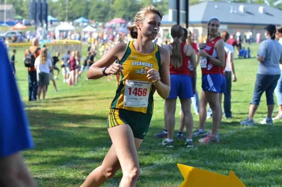 Senior Alora Reiff races at the St. Xavier Invitational. GMC's is her last race in her six year running career which started in seventh grade. She hopes to set a personal record. Photo Courtesy of Nancy Belcher