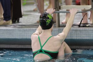 Mary Fry, 10 readies herself to dive in for her backstroke event. Fry swims for the Blue Ash YMCA as well as for the high school. She will be practicing with Blue Ash this year and not the high school. (Photo courtesy of McDaniel's Photography).