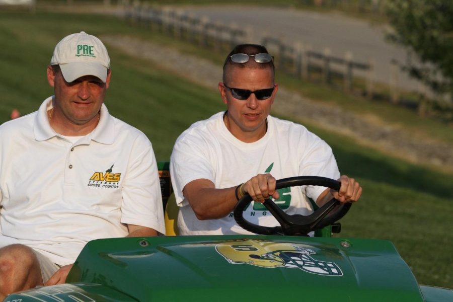 The girls cross country coach, Steve Nester. He is riding in front of the Cross Country team. He is riding with Dan Buchanan, Assistant A.D. at the GMCs. Photo courtesy of McDaniel's photography.