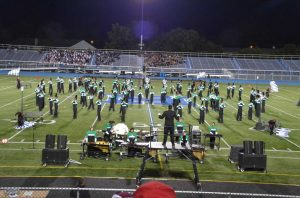 Marching band plays with full force at the Hamilton football game 2013. The marching band performs at all the home half time football games. Recently at Band Night the Marching Band played music with grades 6-8. Photo courtesy of Josh Peck.