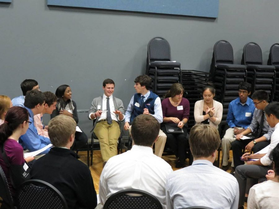 Delegates discuss problems and possible solutions to the assigned issue. This year's conflict at MND was the problem of overpopulation and its correlation with poverty. All of the position papers that were written at the conference passed successfully. Photo courtesy of Beth Leblanc.