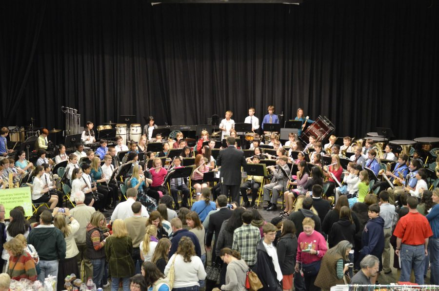 listeners are captivated by the sounds of the musicians. The 8th grade band performs at full force at last years craft show. The show is open for everyone Photo courtesy Fred Peck