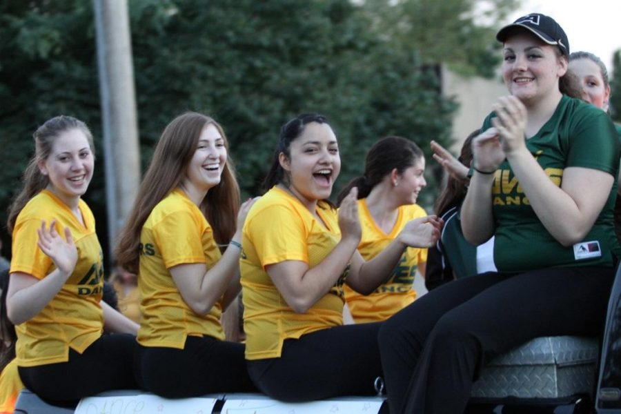 The flyerettes ride in the homecoming parade. They are practicing two times a week to prepare for the basketball season. Preparing for their competition later this school year is also on their minds. Photo courtesy: McDaniel's Photography