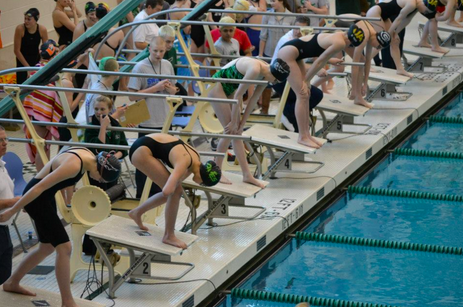 Pricilla Wu, 10 prepares to dive in for her race in the 100 yard  breaststroke at the Sectional meet. Last year Wu qualified for the  Southwest Ohio District Championships. Other than swimming with the high school team, she also swims for the Cincinnati Marlins. (Photo courtesy of Jean Wu).