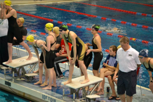 Moreno prepares to dive in at the Southwest District meet. She practices with the Cincinnati Marlins rather than the high school. Her main event is the 50 yard freestyle.    (Photo courtesy of Jean Wu)