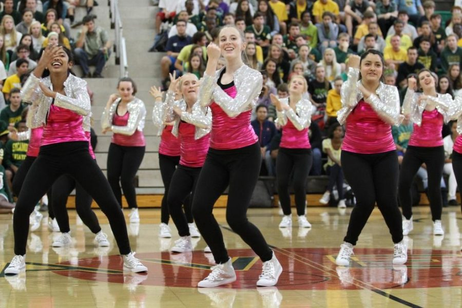 The Flyerettes will be performing the same routine they did at the fall pep rally. They are excitied to show off all their hard work this weekend at UC. The team will be working hard till then to make sure the dance is perfect. Photo courtesy of McDaniels Photography.
