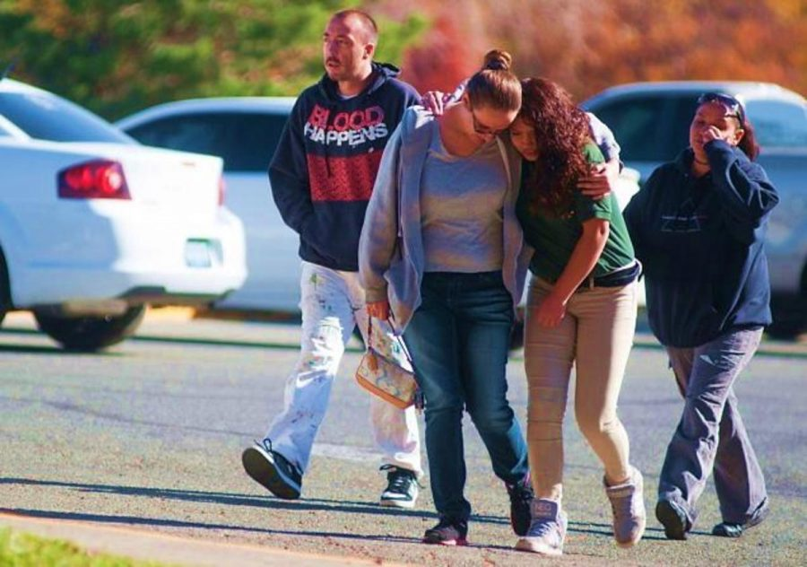 A Sparks Middle School student and her mother walking together after students were evacuated from the school after a shooting at Sparks Middle School in Sparks, Nev. on Monday, Oct. 21, 2013. A student at the Sparks Middle School opened fire on campus, killing a staff member who was trying to protect other children. Other students reunite with their family members and mourn as well. Picture courtesy: MCT Photo service