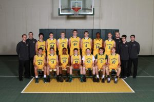 The boys' varsity basketball team after the season. On the sides are the coaches of the team. The varsity went 9-5 last year. Photo courtesy of McDaniel's photography.