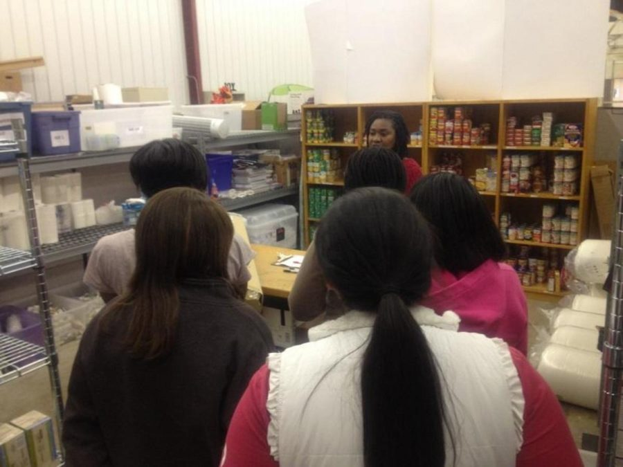 During a building tour, members of the Young Women's Scholars (YWS) group viewed the storage area in OGB. The Holiday store will focus on replenishing the orgination's food and clothing stock to be distributed to families in need. Volunteering at OGB is a great way to get volunteer hours while making an impact in our community. Photo Courtesy of Lauren Saxon.