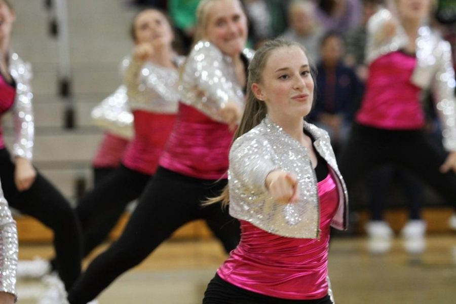 Katie Pruitt, 12 dances hip hop at the pep rally. At the beginning of the dance she hits this pose. She dances outside of school along with the Flyerettes. Photo courtesy of McDaniel's Photography