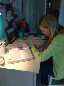 With a schedule of all accelerated classes, Latin four, band, and student council, Augustin manages her time. She gets her assignments done between marching band, jazz band, choir, bells and creative writing.  Here she works on her homework for history. Photo courtesy of Isabelle Augustin.