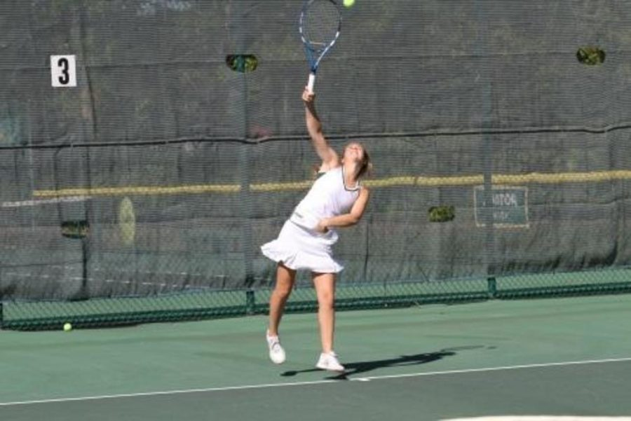 In addition to the multiple offseason exercising, players will also participate in serving practice. The serve is a crucial part of the game. Improving the serve will automatically improve the player's skill.  Photo courtesy of McDaniel's Photography.
