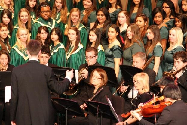 Bella Voce is the academic all-girls choir. They perform solo, but they often team up with the Aviator Chorale or Select to get a fuller, more complete sound. Bella always wear their signature long green dresses, which were newly bought this year to replace their older version. Photo Courtesy of: McDaniel's Photography