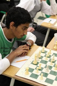 Divyesh Balimurali, 10, the first board, calmly studies his pieces, formulating some method of attack.