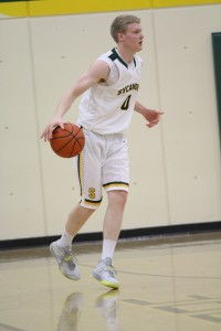 Mitch Hill, 12, brings the ball up the floor. Hill is hoping to have a very successful season, as this one will be his last as an Aviator. He looks to win his second straight GMC Championship.
