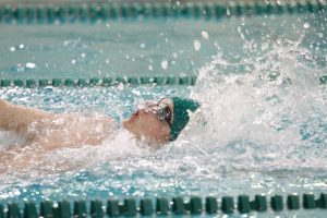 Girten competes in the 100 yard backstroke. He is one of four seniors on the boys' varsity team. Girten mainly swims distance freestyle and backstroke.  (photo courtesy of McDaniel's Photography)