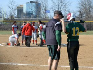 Coach Mark Weigel confers with Becca Plaatje, 12 during the Princeton game. Weigel recently announced that he would be quitting his coaching job. The athletic director is currently choosing a new head coach. Photo Courtesy of Mike Plaatje.