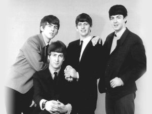 The Beatles coming to America was a big deal. All the Beatles fans waited for them at the airport. Their performance on the Sullivan Show will go down in history as one of the greatest ever. Photo curtsey of MTC photo.