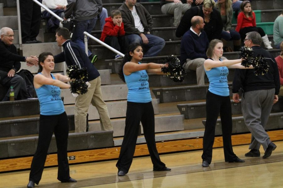 Carly Lefton, 12, Rupali Jain, 12, Katie Pruitt, 12, at the boys Varsity basketball game. The Flyerettes performed at halftime along with the cheerleaders. They danced their pom routine. Photo courtesy of McDaniel's Photography