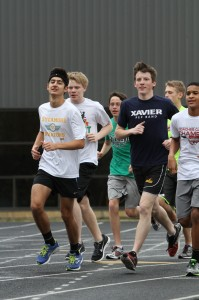 """The Winter Track distance athletes run a workout outside on one of the nicer days of the winter. Indoor track runners build both their physical conditioning as well as trust throughout the season, providing a foundation for the spring athletes entering in early March. """"Yes, we do have hard workouts and bad days, but winter track is fun because of the people I am with every day. They motivate me,"""" said Lisa Ruffin, 11. Photo courtesy of McDaniel's Photography"""
