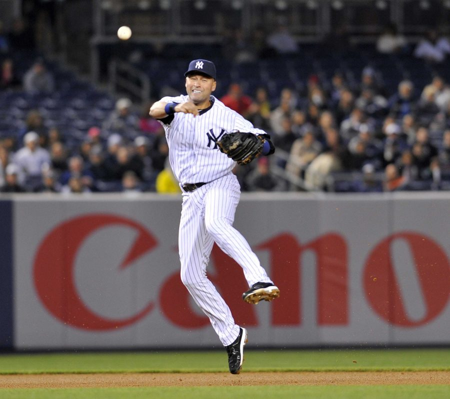 Derek Jeter throws out Nick Markakis with his classic jump-throw. Jeter has been the New York Yankees everyday shortstop for the last 19 seasons. He will be retiring at the end of 2014. Photo Credit: MCT Direct