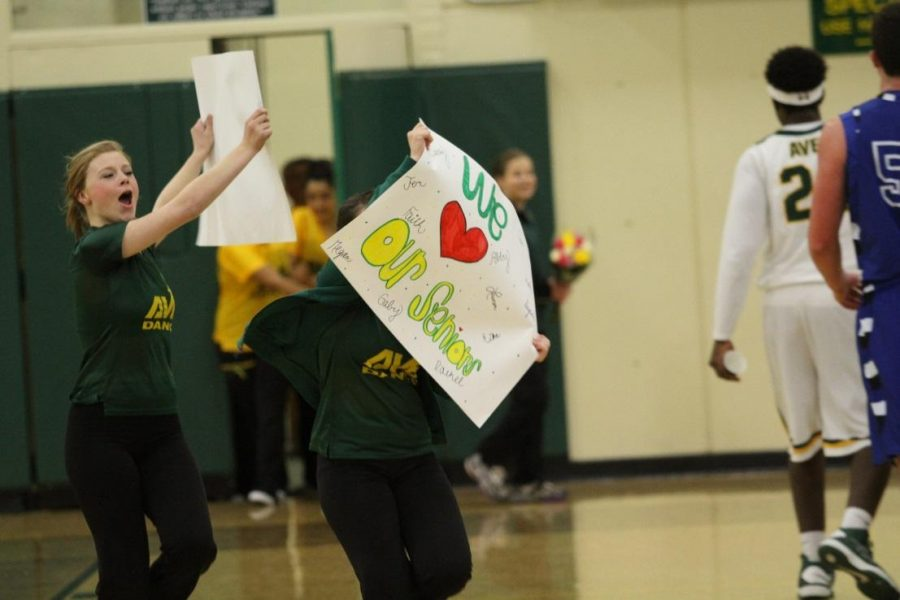 Hannah Young, 9 and Lindsay Altemuehle, 9 on Senior Night. The seniors danced their own dance to show off everything they have learned while being on the team. The underclassman decorated the seniors' lockers that day. Photo courtesy of McDaniel's Photography