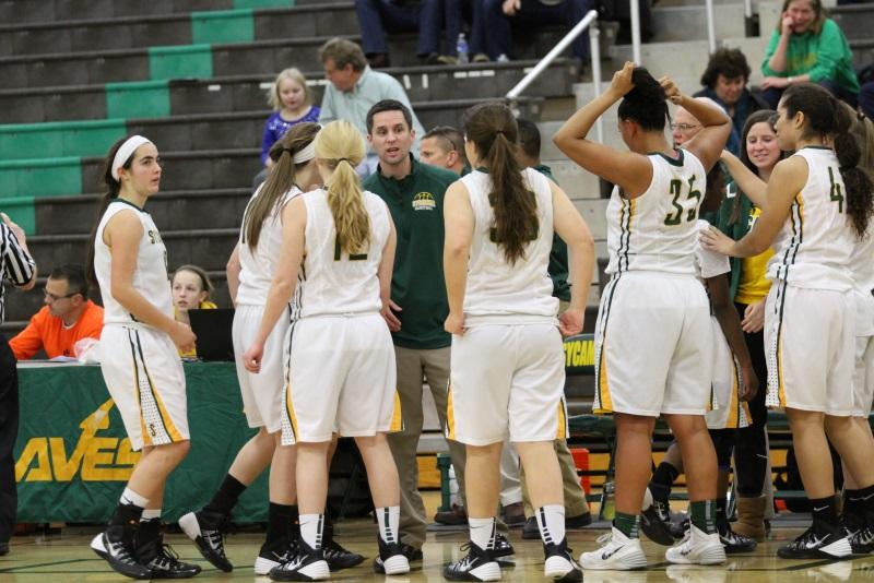 Coaching in the huddle, Derek Christerson, Varsity head coach, explains the strategies the team should execute to improve their score. The Varsity team competed against the Princeton Vikings on senior night. Throughout the course of the season, the players grew very close as teammates and also as friends. Photo courtesy of McDaniel's photography.