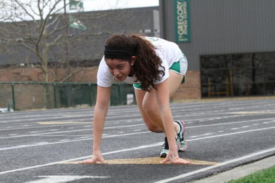 Carly Lefton, 12, practices starts on one of the few warm days during the Winter Track season. She competed in three events at the Capital University High School Invite- the 60 meter dash, 200 meter dash, and the 800 meter relay. Three events were a common number among the members of the small team.  Photo courtesy of McDaniel's Photography.