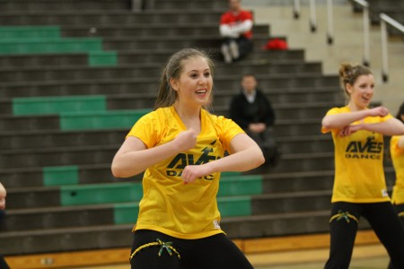 Samantha Weiss, 12 is performing during Senior Night. Sam was part of Inter Act Club for 3 years. She enjoyed volunteering with the school but was overwhelmed by the large number of members. Photo courtesy of McDaniel's Photography.