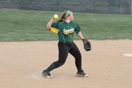 During practice the players always work on in field drills. They work on them in worm ups and when the coaches are hitting balls to them. Kelly Borman, 12 was able to field this ball and make a great play. Photo courtesy of McDaniel's photography.