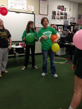 """When the class has some down time, instead of watching a movie they play games with a bigger meaning behind them. """"I am not going to tell you why we are doing these things, but everyone take off their shoes,"""" said Mrs. Googins as the class started this day of fun. The class played keep the balloon up and also was blindfolded and had to find their shoes. The point of the games were to display that teachers cannot take on everything and need to delegate to be efficient."""