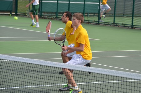 The doubles team of Mustafa Ahmad, 12, and Noah Stern, 9 played a large part in the team's victories over Mason and Upper Arlington. Here, Ahmad lunges for a volley. The team will take on Centerville in the first round of the State tournament. Photo courtesy of Fred Peck Photography.