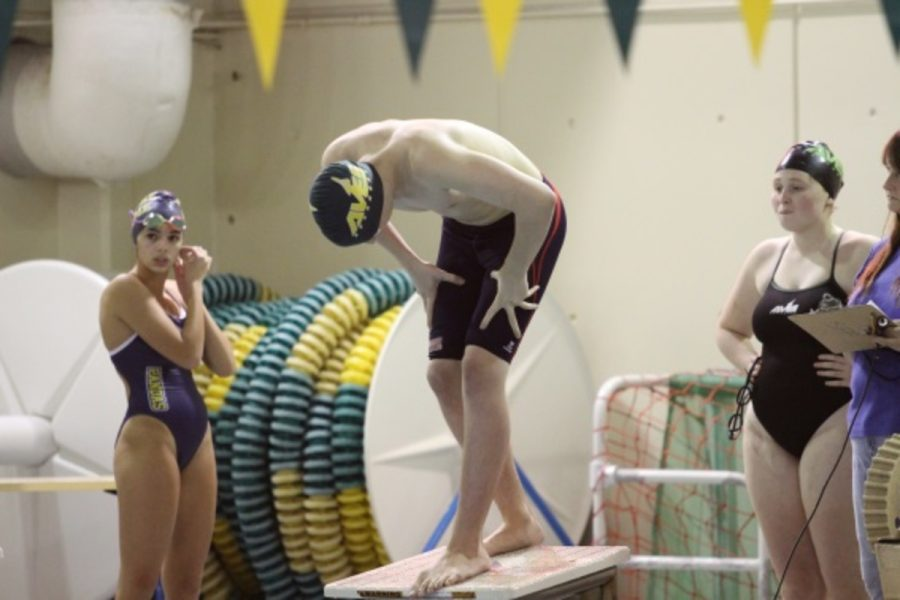 Eamund Bell, 10 prepares to dive in for his race. Bell practices with the Cincinnati Marlins outside of the high school season. There are four sites of the Marlins and he trains at the East site or the Sycamore site. (Photo courtesy of McDaniel's photography)